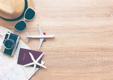 Tourist travel planning concept on map with passport, airplane, camera,hat and sunglasses. Stock Photo