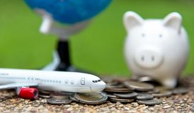 Tourist travel planning for saving money in the piggy for travel airplane with around the world. Stock Image