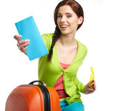 Tourist with travel suitcase and boarding pas Royalty Free Stock Images