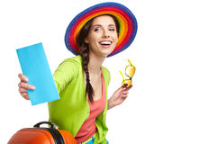 Tourist with travel suitcase and boarding pas stock photo