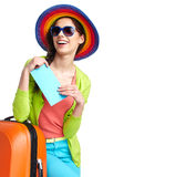 Tourist with travel suitcase and boarding pas. Portrait of female tourist with travel suitcase and boarding pass Royalty Free Stock Photos