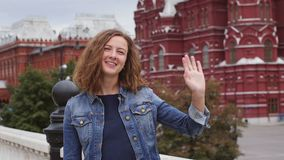 Tourist on travel waving hand saying hello. Russian, Moscow, Kremlin stock footage