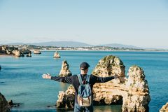 Tourist or traveler with a backpack on the Atlantic coast. A tourist or traveler with a backpack admires the beautiful view of the Atlantic Ocean and the coast Royalty Free Stock Photos