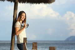 Tourist traveler girl enjoying holidays looking a seascape on the beach Royalty Free Stock Photos