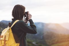 Tourist traveler photographer taking pictures of amazing landscape on vintage photo camera on background valley view mockup sun royalty free stock image