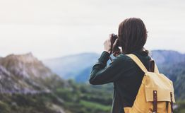 Tourist traveler photographer taking pictures of amazing landscape on vintage photo camera on background valley view mockup sun royalty free stock photo
