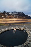 Tourist traveller man soaking in natural hot spring in Iceland Royalty Free Stock Image
