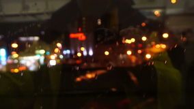 Tourist traveller point of view. City light from POV in rainy day through train window at night stock footage