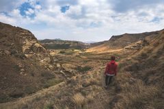 Tourist trekking on marked trail in the Golden Gate Highlands National Park, South Africa. Scenic table mountains, canyons and cli Stock Photo