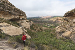 Tourist trekking on marked trail in the Golden Gate Highlands National Park, South Africa. Scenic table mountains, canyons and cli Stock Images