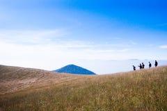 Tourist trekking on Mountain peak Royalty Free Stock Photos