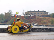 Tourist on tricycle has a rest. After rain near the bay, Helsinki Royalty Free Stock Images