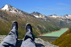 Tourist on a trip in Alps in the Swiss canton of Valais. In the background dam of Mattmark royalty free stock image