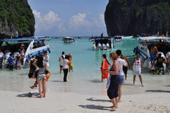 Tourist on a tropical beach Maya Bay. Tourists on a visit to The Beach used in the movie The Beach. Maya Bay Royalty Free Stock Photo