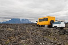Tourist truck with volcanic landscape of Iceland royalty free stock images