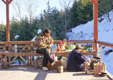 Tourist trying hot snacks at Patnitop. With temperature below zero, a tourist having some hot snacks at Patnitop,North India Royalty Free Stock Photos