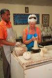 Tourist trying pottery at Ephesus Stock Photos