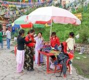 Tourist trying traditional ethnic costume at Ganeshtok, near Gangtok,Sikkim. Tourist trying traditional ethnic costume called as Kho at Ganeshtok, near Gangtok Stock Image