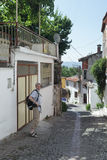 Tourist in Turkish town. Tourist with backpack on a narrow street of Bergama, Turkey Royalty Free Stock Photo