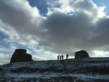 Tourist and Urho Ghost City in Winter. Tourists are in Urho Ghost City at sunset time in winter. Yardang landforms in Xinjiang,China. Located 100 km northeast Royalty Free Stock Photography