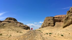Tourist and Urho Ghost City, Xinjiang China. A lady is walking in Urho Gohost City. Yardang landforms in Xinjiang,China. Located 100 km northeast of Karamay Stock Images