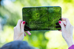 Tourist using augmented reality on a transparent tablet. Hands of a woman, concept of tourist using augmented reality on a high tech transparent digital tablet stock photography