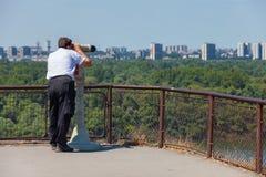 Tourist using binoculars Stock Images