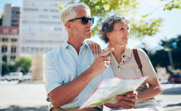 Tourist using city map for directions royalty free stock photo