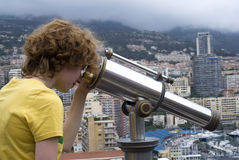 Tourist using coin telescope Stock Photo
