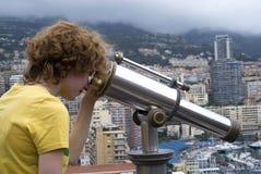 Tourist using coin telescope Stock Photo