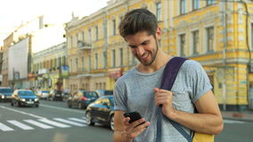 Tourist using his phone in the center of a city. Young teenager using his phone Stock Image