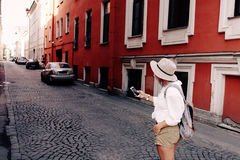 Tourist using navigation app on the mobile phone. Travel concept Stock Photos