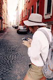 Tourist using navigation app on the mobile phone. Travel concept Stock Photo