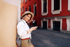 Tourist using navigation app on the mobile phone. Travel concept Stock Photography