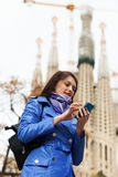 Tourist using smartphone Royalty Free Stock Photos