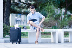 Traveler Reading Tablet. A young male tourist orienting using a tablet Royalty Free Stock Photos