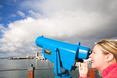 Tourist using telescope Stock Photo