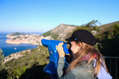 Tourist using telescope Royalty Free Stock Photo