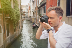 Tourist in Venice taking pictures with digital camera Royalty Free Stock Photo