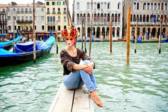 Tourist in Venice wearing a carnival mask Royalty Free Stock Image