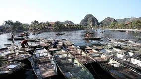 Popular Boat Tours in Tam Coc Vietnam. Tourist Vietnam Tam Coc . Boating on beautiful places and caves stock footage