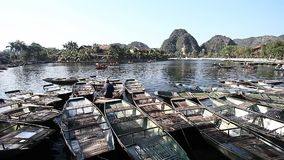 Traveling in Vietnam Tam Coc. Tourist Vietnam Tam Coc . Boating on beautiful places and caves stock footage