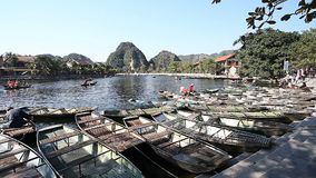 Tourist Vietnam Tam Coc. Boating on beautiful places and caves stock video
