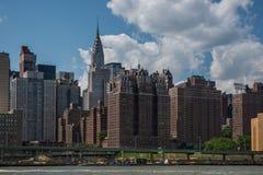 New York City. Skyline against blue cloudy sky royalty free stock photo