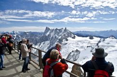 Tourist at view point. Aiguille Du Midi - the mountain peak in French Alps, Chamonix. in the picture: tourists enjoying the views from the top (altitude 3,842 m Stock Photography