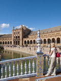 Tourist viewing ornate building in Plaza de Espana, Seville, Spain Royalty Free Stock Images