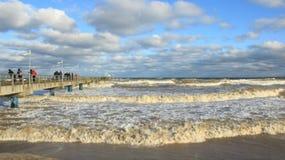 Tourist Viewing Storm Sea Wave On Long Bridge stock photography