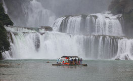 Tourist visit and charm Ban Gioc waterfall Stock Image
