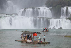 Tourist visit and charm Ban Gioc waterfall Royalty Free Stock Photography