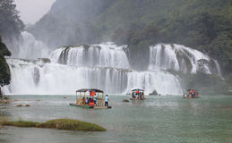 Tourist visit and charm Ban Gioc waterfall Royalty Free Stock Photo